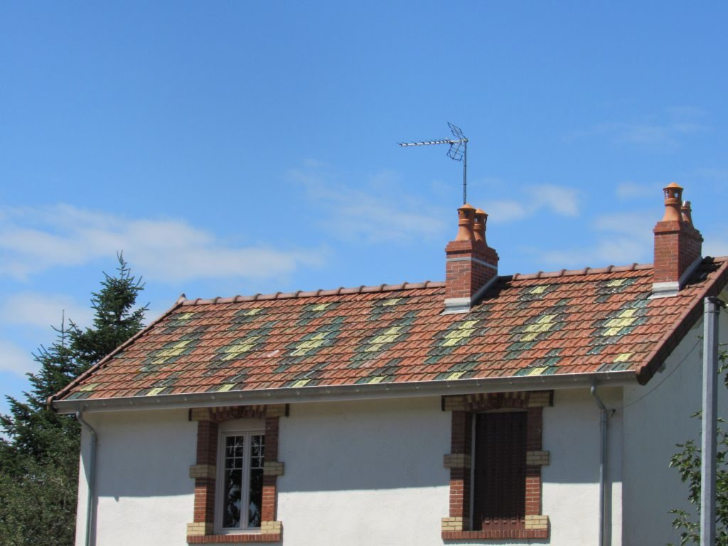 Glazed roof tiles of the area