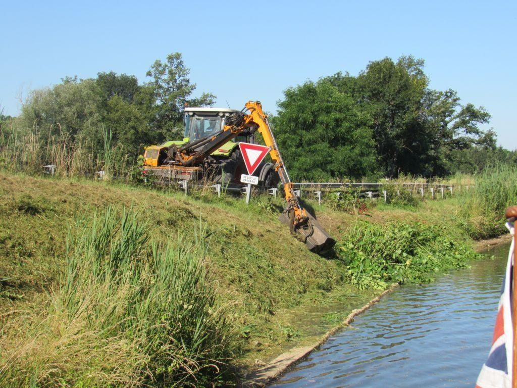 Grass cutting along canal