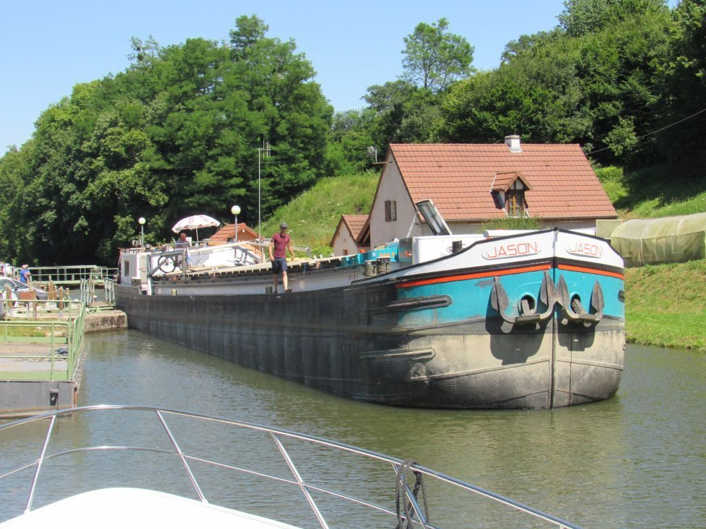 Large commercial barges coming through